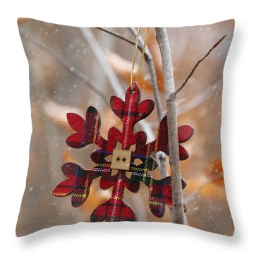 Throw Pillow featuring the photograph Ornament Hanging On Branch With Snow Falling by Sandra Cunningham