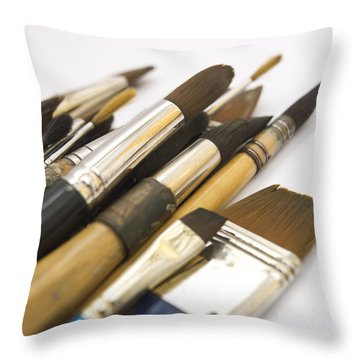 Paint Brushes Throw Pillow by Bernard Jaubert