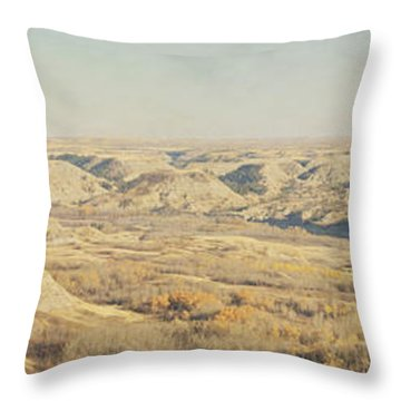 Panoramic Of The Badlands Of The Red Throw Pillow by Roberta Murray