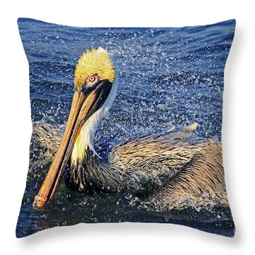Showering Pelican Throw Pillow by Larry Nieland
