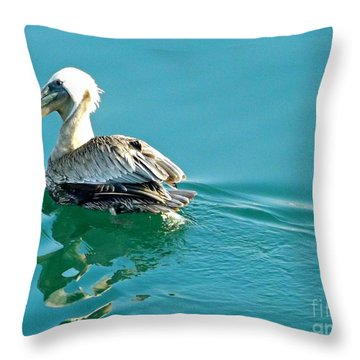 Throw Pillow featuring the photograph Pelican Swimming by Clare Bevan