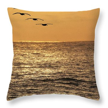 Pelicans Ocean And Sunsetting Throw Pillow by Tom Janca