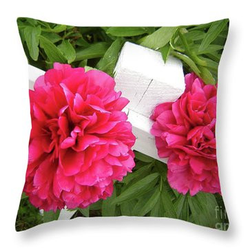 Throw Pillow featuring the photograph Peonies Resting On White Fence by Barbara Griffin