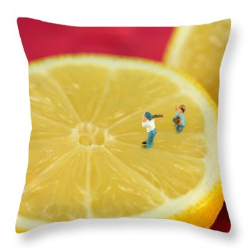 Playing Baseball On Lemon Throw Pillow by Paul Ge