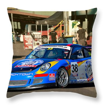 Porsche In The Pits Throw Pillow