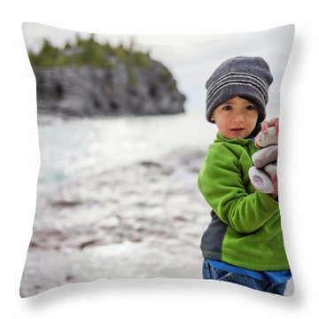 Portrait Of Little Boy Standing At Lake Throw Pillow