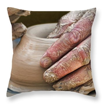 Potter's Wheel Throw Pillow