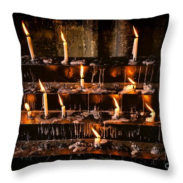 Prayer Candles Throw Pillow by Adrian Evans