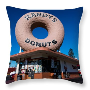 Randy's Donuts Throw Pillow by Stephen Stookey