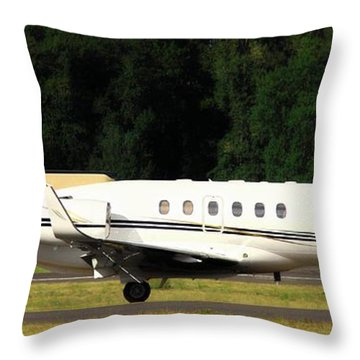 Airplanes Throw Pillow featuring the photograph Raytheon Hawker 800xp by Aaron Berg