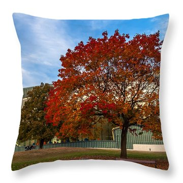 Throw Pillow featuring the photograph Red And Yellow Tree At The Front Of The Museum Of The History Of Polish Jews In Warsaw by Julis Simo