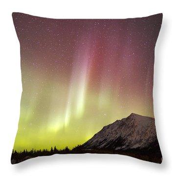 Red Aurora Borealis Over Carcross Throw Pillow by Joseph Bradley