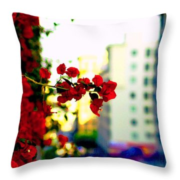 Throw Pillow featuring the photograph Red Flowers Downtown by Matt Harang