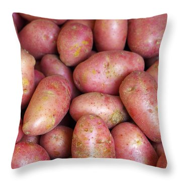 Red Potatoes Throw Pillow by Carlos Caetano