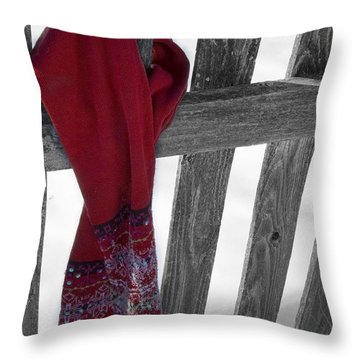 Red Scarf Hanging On Fence Throw Pillow by Birgit Tyrrell