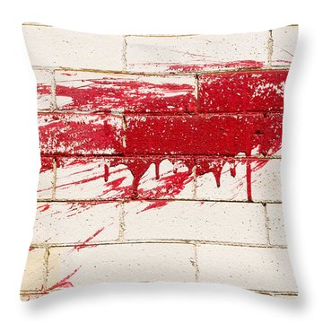 Red Splash On Brick Wall Throw Pillow