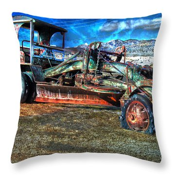 Throw Pillow featuring the photograph Retired Caterpillar by Gunter Nezhoda