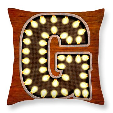 Throw Pillow featuring the digital art Retro Marquee Lighted Letter G by Mark Tisdale
