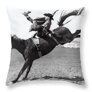 Riding A Bucking Bronco Throw Pillow