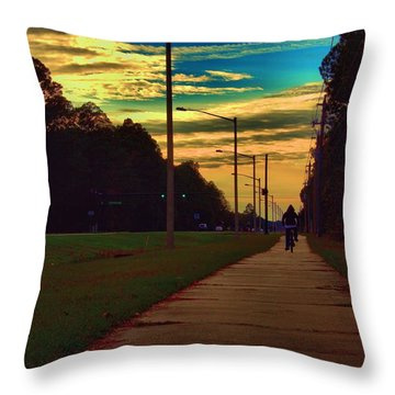Throw Pillow featuring the photograph Riding Into The Sunset by Tyson Kinnison
