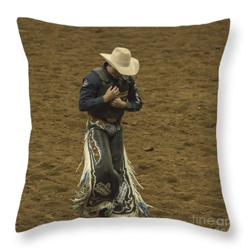 Rodeo Cowboy Dusting Off Throw Pillow by Janice Rae Pariza