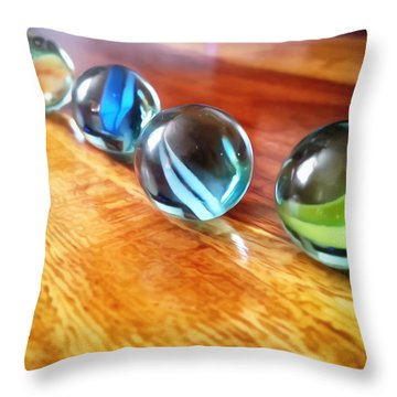 Row Of Marbles Throw Pillow