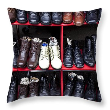Rows Of Shoes Throw Pillow by Garry Gay