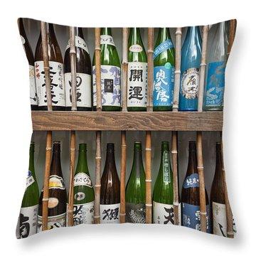 Throw Pillow featuring the photograph Sake Bottles by Bryan Mullennix