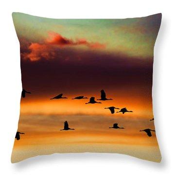 Sandhill Cranes Take The Sunset Flight Throw Pillow by Bill Kesler