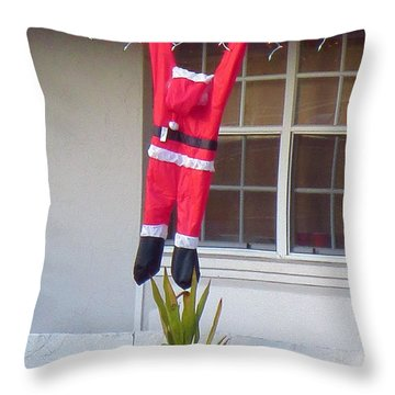 Santa Hanging From The Roof In Ft. Myers Florida. Throw Pillow