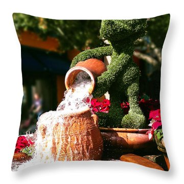 Throw Pillow featuring the photograph Santa Mickey Topiary Fountain by Doug Kreuger