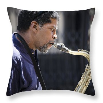 Saxophone Player Throw Pillow by Carolyn Marshall