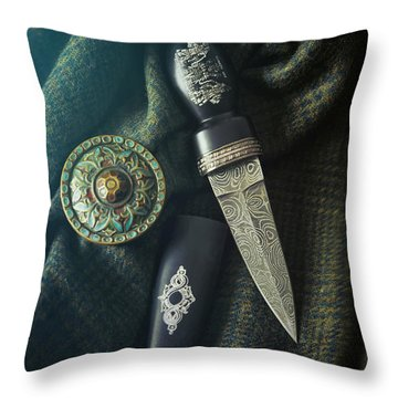 Throw Pillow featuring the photograph Scottish Dirk And Celtic Pin Brooch On Plaid by Sandra Cunningham