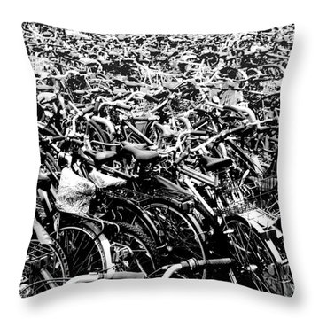 Throw Pillow featuring the photograph Sea Of Bicycles 3 by Joey Agbayani