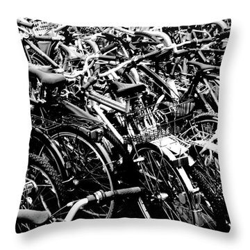Throw Pillow featuring the photograph Sea Of Bicycles 2 by Joey Agbayani