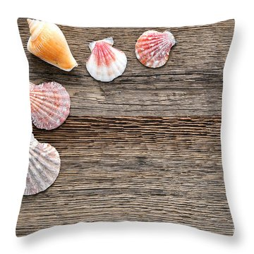 Seashells On Wood Throw Pillow by Olivier Le Queinec