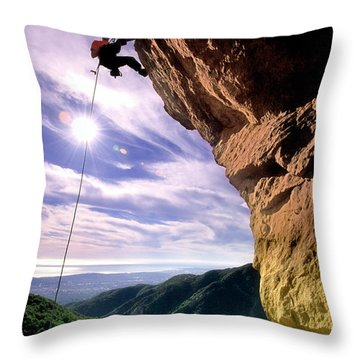 Silhouetted Climber Rapelling Throw Pillow