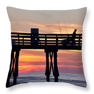 Silhouetted Fisherman On Ocean Pier At Sunrise Throw Pillow