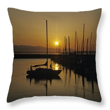 Silhouetted Man On Sailboat Throw Pillow