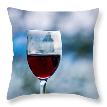 Single Glass Of Red Wine On Blue And White Background Throw Pillow by Photographic Arts And Design Studio