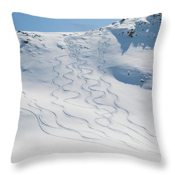 Ski Tracks In The Snow On A Mountain Throw Pillow by Keith Levit