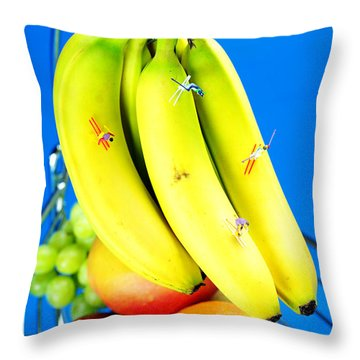 Skiing On Banana Little People On Food Throw Pillow by Paul Ge