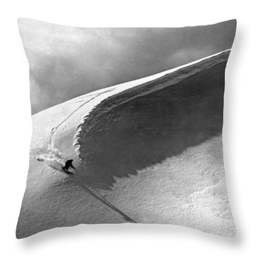Skiing Under A Curl Throw Pillow by Underwood Archives