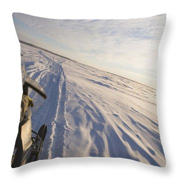 Snowmachiner Following Trail On Frozen Throw Pillow by Kevin Smith
