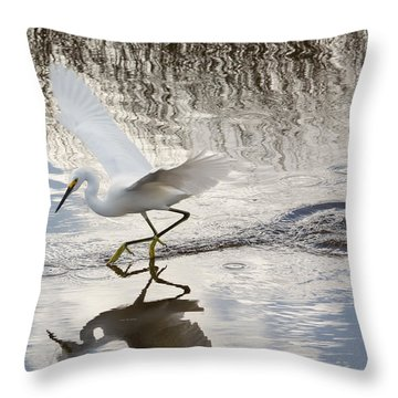 Snowy Egret Gliding Across The Water Throw Pillow