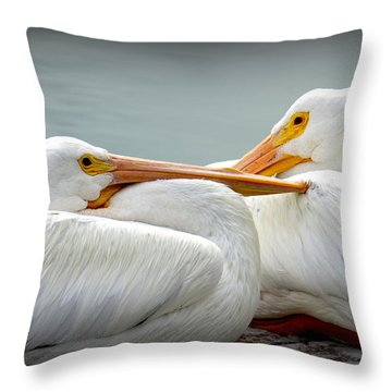 Snuggly Pelicans Throw Pillow by Laurie Perry