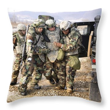 Soldiers Conduct Medical Evacuation Throw Pillow by Stocktrek Images