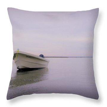 Solitary Boat Throw Pillow by Adam Romanowicz