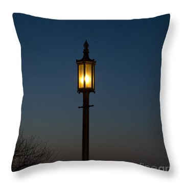 Solitary Gas Light Throw Pillow by Tim Mulina