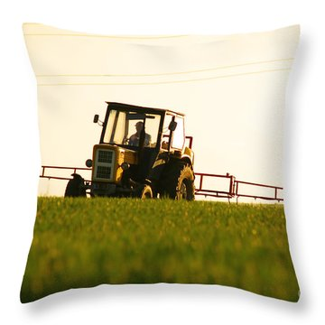 Spraying The Crop Throw Pillow by Michal Bednarek